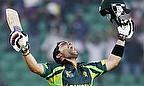 Umar Akmal celebrates his century