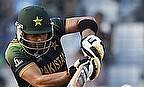 Umar Akmal hits a shot
