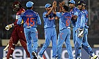 India celebrate the wicket of Chris Gayle