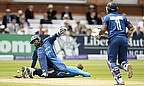 Dilshan survived this collision with Joe Root to help Sangakkara set up Sri Lanka's score