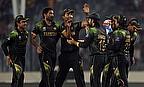 Pakistan players celebrate a wicket