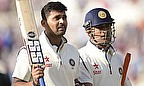 Murali Vijay and MS Dhoni leave the field