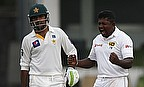 Rangana Herath (right) celebrates the dismissal of Asad Shafiq