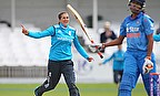 Jenny Gunn (left) celebrates after dismissing Jhulan Goswami (right) caught and bowled