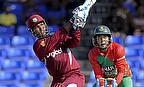 Denesh Ramdin hits a six as Mushfiqur Rahim looks on