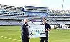 Lord's Taverners CEO Paul Robin and Chris Woakes show off the winning design - by Liam Hall-Hicks