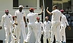 The West Indies celebrate the wicket of Shafiul Islam