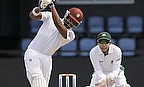Darren Bravo (left) has been fined 30 per cent of his match fee