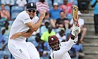 Alastair Cook (left) looks to avoid a drive from Marlon Samuels during day one of the second Test in Grenada.