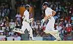 Moeen Ali (left) and Alastair Cook (right) in action during the third Test against West Indies in Barbados.
