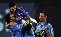 Virat Kohli, Suresh Raina and MS Dhoni celebrate their semi-final win over South Africa
