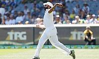 Monty Panesar fields the ball