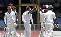 The West Indies celebrate the wicket of Imrul Kayes