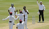 Sulieman Benn celebrates the wicket of Anamul Haque