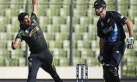 Sohail Tanvir bowls, Kane Williamson looks on