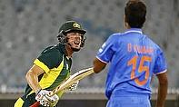 James Faulkner (left) celebrates hitting the winning runs against India in Melbourne