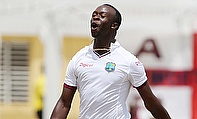 Kemar Roach celebrates the wicket of Jos Buttler during day two of the first Test in Antigua.