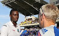 Jason Holder (left) congratulated by England coach Peter Moores (right) after the first Test in Antigua.