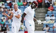 Stuart Broad (left) celebrates the wicket of Jason Holder (right) during day two of the second Test in Grenada.