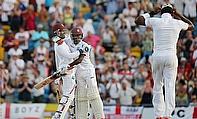 West Indies' players celebrate their win over England in the Third Test in Barbados.