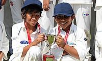 Oscar Fernandes McDonald (left) collects the Spirit of Cricket award