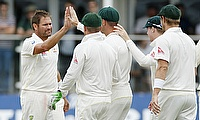 Australia's Ryan Harris (left) celebrates with team mates after taking the wicket of Kent's Sam Billings during the warm-up game in Canterbury.