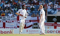 Marlon Samuels makes a run as Ben Stokes looks on