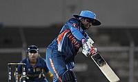 MD Thirush Kamini plays a shot