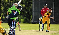 PNG's Norman Vanua bowls out Ireland's Paul Stirling.