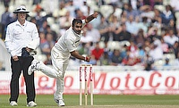 Amit Mishra bowls against England in 2011