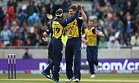 Birmingham Bears players celebrate a wicket