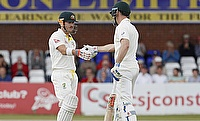 David Warner (left) and Shaun Marsh (right) scored centuries as Australia ended day one on 413 for nine against Derbyshire,