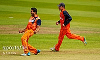 Mudassar Bukhari (left) celebrating the wicket of Ireland captain, William Porterfield.