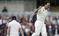 Mitchell Johnson (right) celebrating his 300th dismissal in Test cricket.