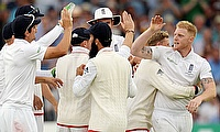 Ben Stokes celebrating the dismissal of Peter Nevill along with his teammates.