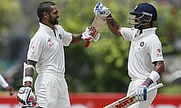 Shikhar Dhawan (left) and Virat Kohli (right) put on a 227-run partnership for the third wicket as India dominated Sri Lanka on day two of the first T