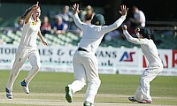 Ellyse Perry (left) celebrates one of her six wickets that bowled Australia to victory on the final day