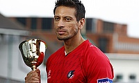 Sajid Mahmood poses with the County Championship trophy during his time with Lancashire
