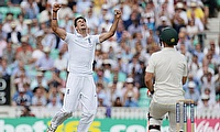 Steven Finn (left) celebrating the dismissal of Mitchell Marsh (right) on day two of the fifth Ashes Test at The Oval.