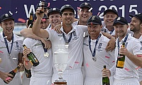 England's Alastair Cook celebrates with team mates and the urn after winning the ashes.