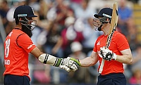 Moeen Ali (left) and Eoin Morgan (right) added 135 runs for third wicket as England defeated Australia in the only T20I in Cardiff by five runs.