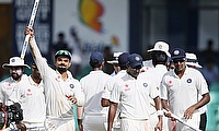 India's captain Virat Kohli (left) shows a stump as he celebrates with his teammates after they won their final Test cricket match and the series agai