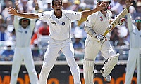 Rogers (second right) pictured here about to be given out during his Test debut in 2008