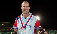 Help for Heroes XI's captain Andrew Strauss celebrates with the trophy.