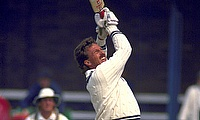 Sir Ian Botham in action