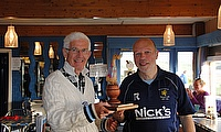 David Mackay (left) presents the Tartan Duck trophy to Hillhead's Ian Holland