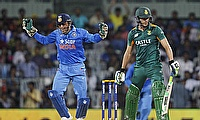 Indian captain MS Dhoni (left) celebrating the wicket of South Africa's Faf du Plessis (right) in the fourth ODI in Chennai.