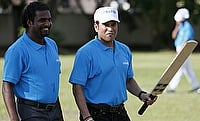 Sachin Tendulkar (right) shares a moment with Muttiah Muralitharan (left) during an inaugural event organized by UNICEF aimed at improving hygiene and