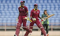 Twin sisters Kyshona and Kycia Knight celebrate victory in the Super Over against Pakistan