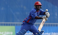 Mohammad Shahzad century powers Afghanistan to four-wicket win